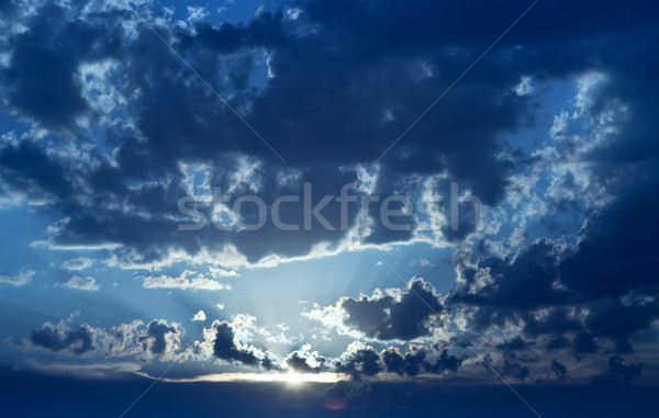Dawning under the dissolving clouds blanket Stock photo © lightkeeper