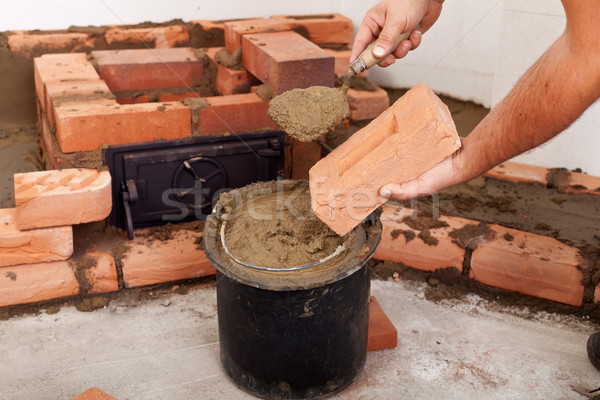 Starting to build a stove - closeup on hands Stock photo © lightkeeper