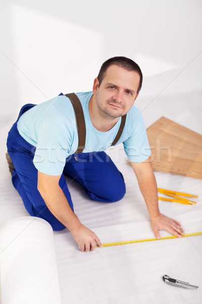 Man laying laminate floor at home Stock photo © lightkeeper