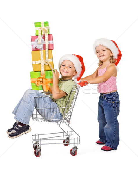 Boldog gyerekek ajándékok karácsony bevásárlókocsi vásárlás Stock fotó © lightkeeper