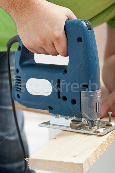 Carpenter or joiner working with electric saw Stock photo © lightkeeper