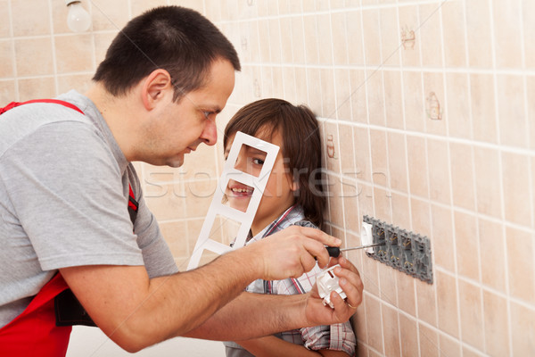 Boy assisting his father in electrician work Stock photo © lightkeeper