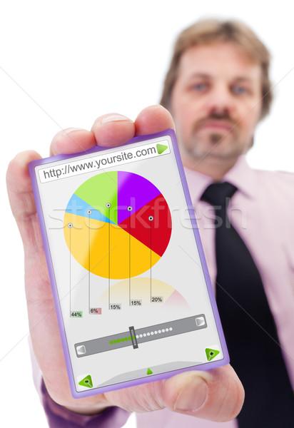Businessman with smart gadget Stock photo © lightkeeper