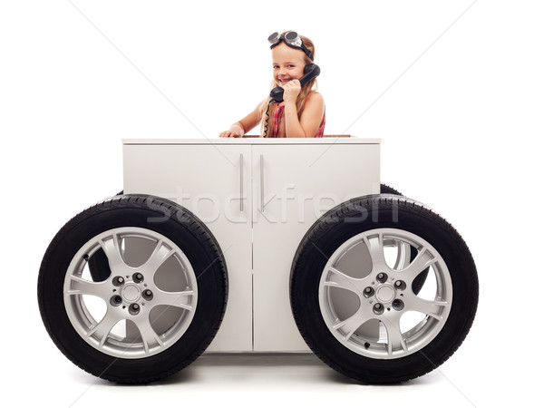 Mobile office concept with little girl on the phone Stock photo © lightkeeper