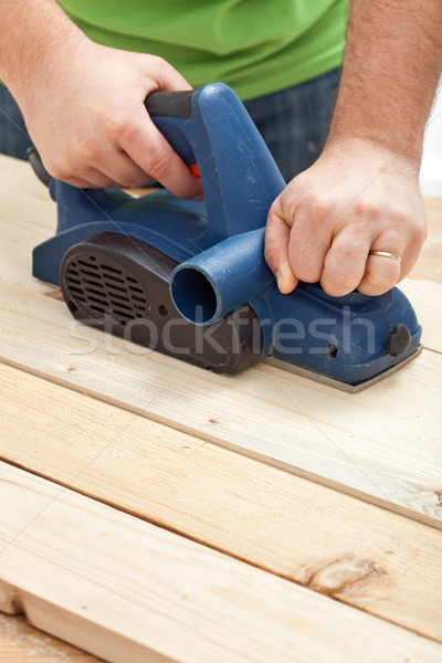 Construction worker hands with electric planer Stock photo © lightkeeper