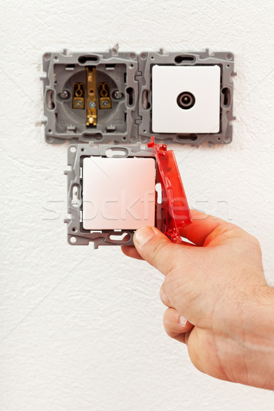Changing a defective electrical wall fixture Stock photo © lightkeeper