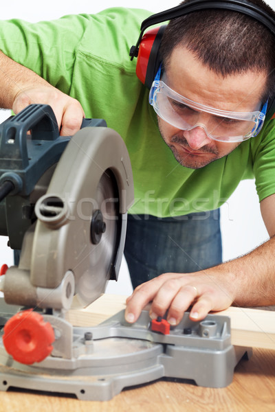 Carpenter or joiner working with power tool Stock photo © lightkeeper