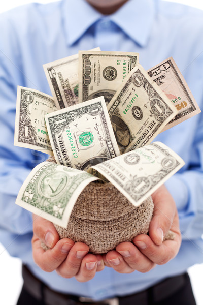 Businessman with money bag full of dollars Stock photo © lightkeeper