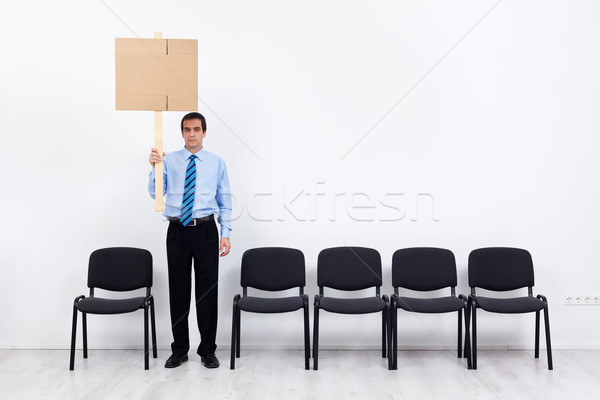 Lonely protesting businessman or employee holding placard Stock photo © lightkeeper