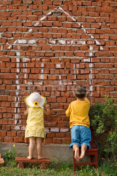 Two kids drawing a home Stock photo © lightkeeper