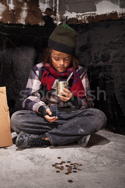 Poor beggar child boy reviews the money he received Stock photo © lightkeeper