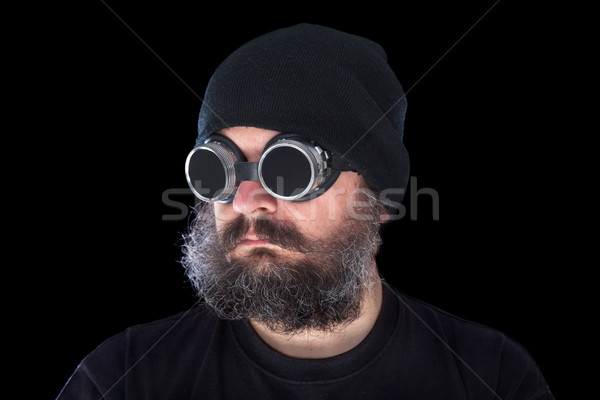 Weird guy with vintage welding goggles on black background Stock photo © lightkeeper