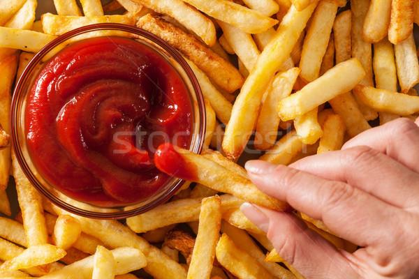 手 フライドポテト トマトソース ケチャップ 先頭 表示 ストックフォト © lightkeeper
