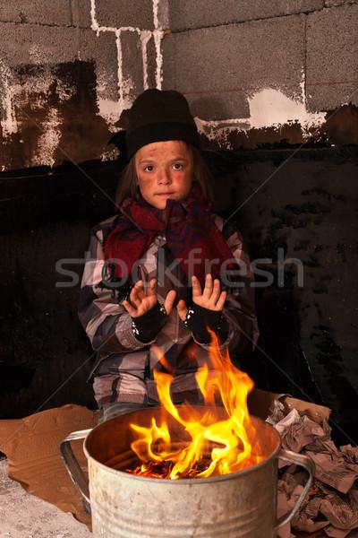 Fiatal hajléktalan fiú utca kezek újság Stock fotó © lightkeeper
