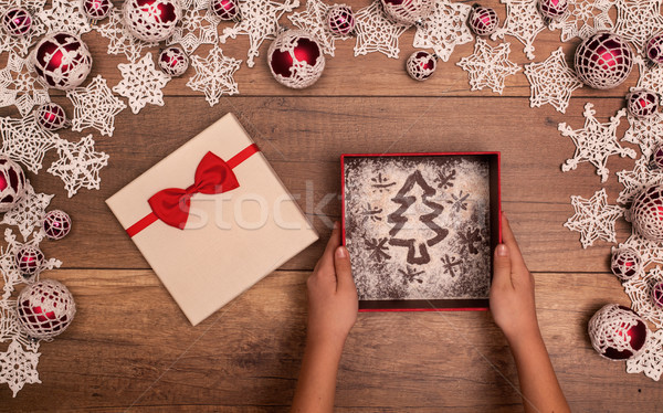 Stock photo: Hands giving or receiving christmas present - in seasonal frame