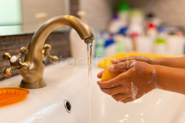 Child washing hands at the bathroom faucet Stock photo © lightkeeper