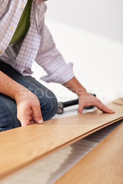 Laying laminate flooring - closeup Stock photo © lightkeeper
