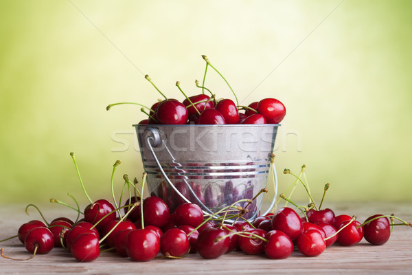 Lots of cherries on old table Stock photo © lightkeeper