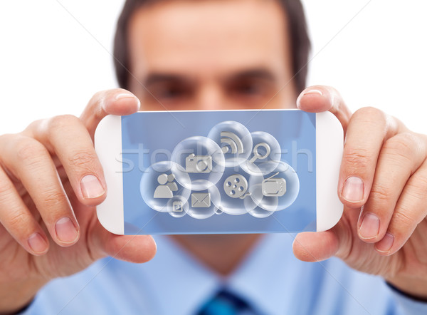 Businessman with smart gadget accessing cloud applications Stock photo © lightkeeper