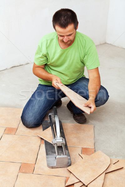 Worker cutting ceramic floor tiles Stock photo © lightkeeper