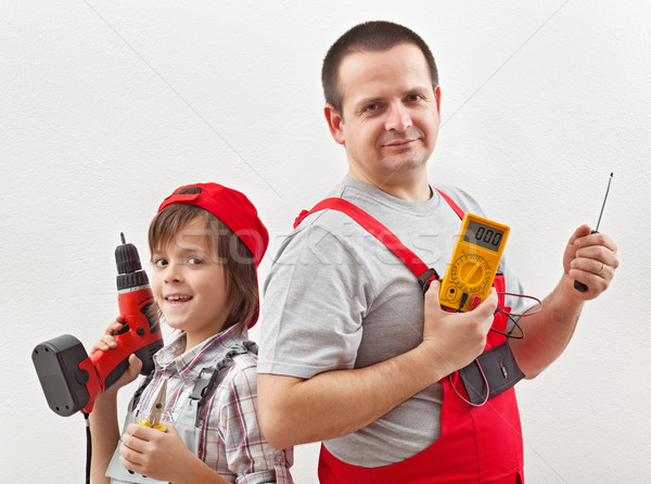 Electrician father and helping son ready for work Stock photo © lightkeeper
