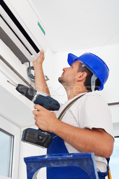 Installing air conditioning unit Stock photo © lightkeeper