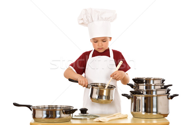 Serious kid chef checking the food Stock photo © lightkeeper