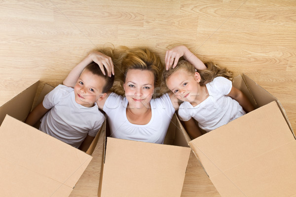 Happy family unpacking Stock photo © lightkeeper