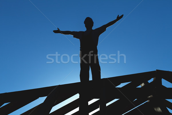 Worker welcoming the sun starting the workday Stock photo © lightkeeper