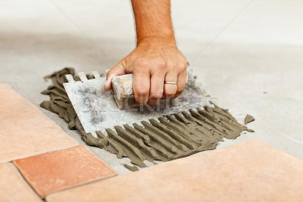Laying ceramic floor tiles Stock photo © lightkeeper
