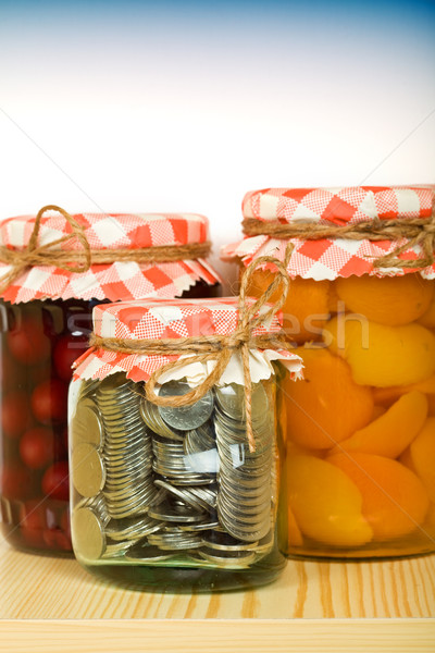 Dinero ahorro monedas jar fondo financiar Foto stock © lightkeeper