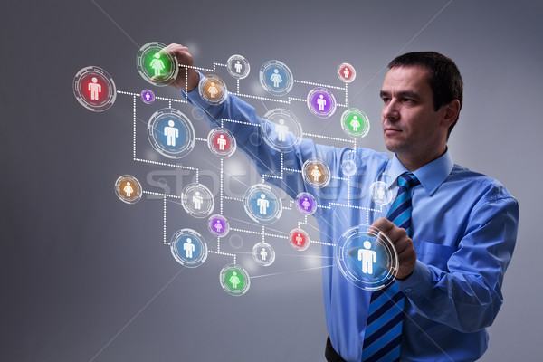 Businessman accessing modern social networking interface Stock photo © lightkeeper