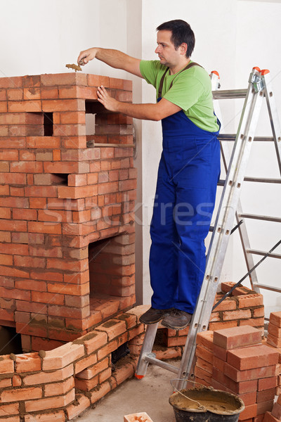 Worker building masonry heater Stock photo © lightkeeper