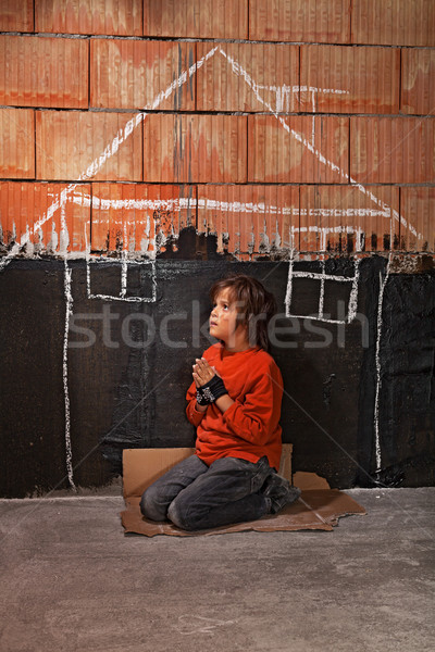 Poor homeless beggar boy praying for a shelter concept Stock photo © lightkeeper