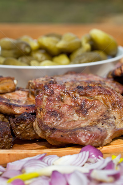 Grilled or barbecued pork meat with onion and pickles Stock photo © lightkeeper