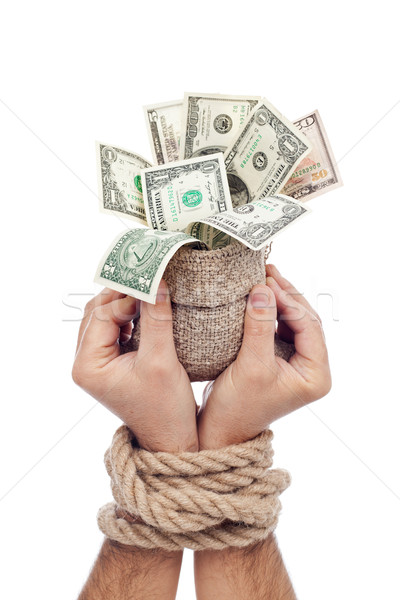 Prisoner of profit - man holding bag of money Stock photo © lightkeeper
