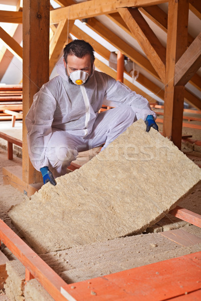 Installing thermal insulation layer on a house Stock photo © lightkeeper