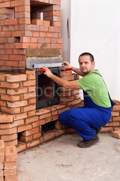 Homme travailleur bâtiment maçonnerie chauffage métallique Photo stock © lightkeeper