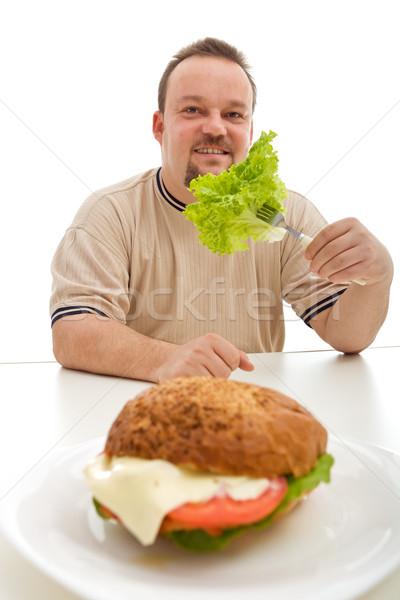 Egészséges étrend lehetőségek túlsúlyos férfi eszik saláta Stock fotó © lightkeeper