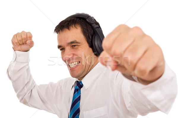 Empresário estresse ouvir música negócio homem Foto stock © lightkeeper
