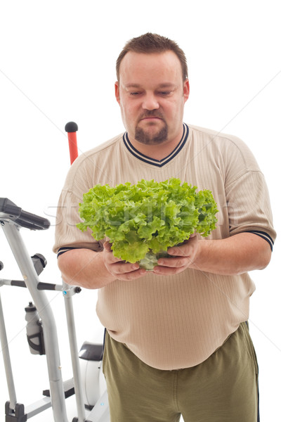 Overweight man not happy about his new diet Stock photo © lightkeeper