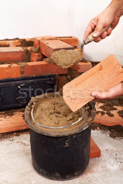 Kamieniarstwo pracownika ręce budynku ognisko Zdjęcia stock © lightkeeper
