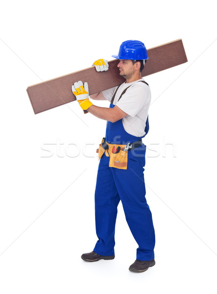 Handyman or worker carrying wooden laminate flooring Stock photo © lightkeeper