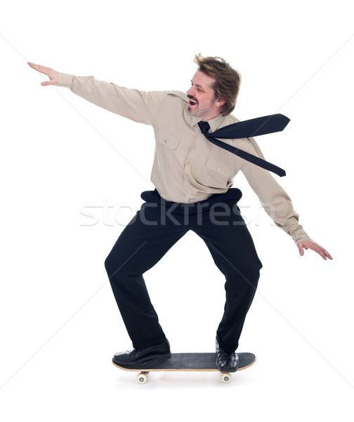 Businessman on skateboard - isolated Stock photo © lightkeeper