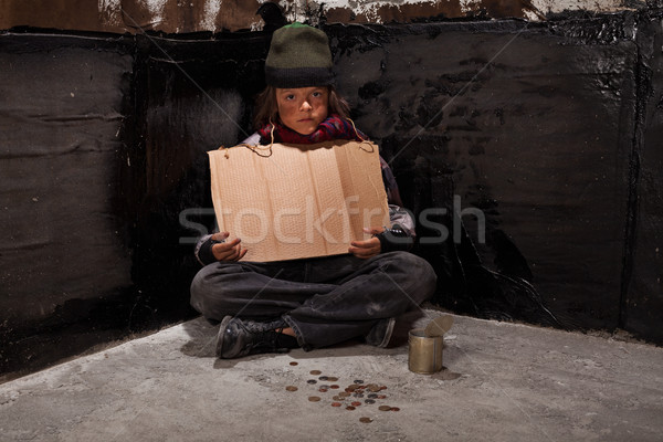 Begging homeless child sitting with a blank sign and some change Stock photo © lightkeeper