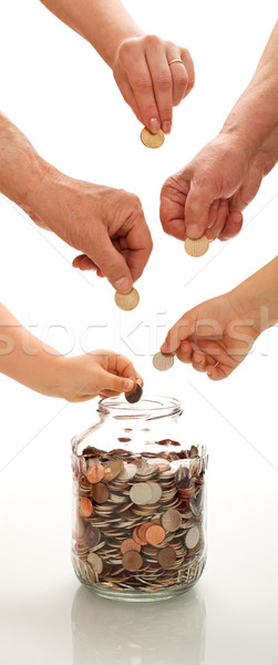 Saving concept with hands of different generations Stock photo © lightkeeper