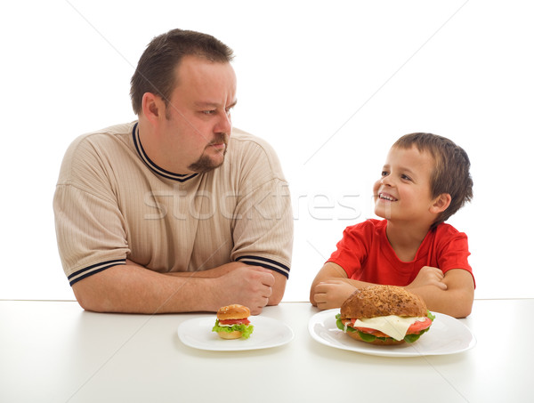 Man and young boy rival over food Stock photo © lightkeeper
