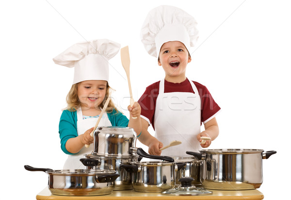 Happy kids dressed as chefs making noise Stock photo © lightkeeper