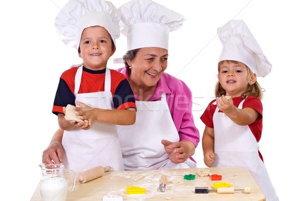 Grandmother with kids making cookies Stock photo © lightkeeper