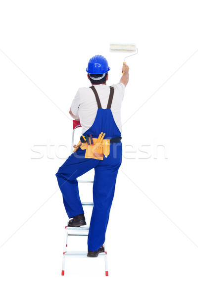 Handyman or worker painting with roller brush on a ladder Stock photo © lightkeeper
